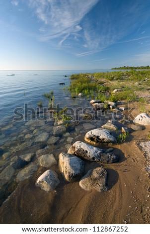 Rocky Lake Huron shoreline along De Tour State Park, Chippewa County, near DeTour, Michigan. Early morning. - stock photo