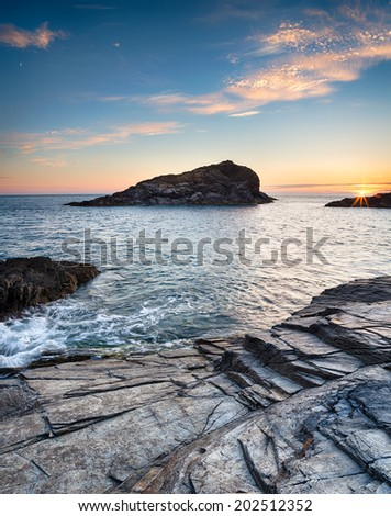 Rocky ledges on the south west coast path near Porthcothan between Newquay and Padstow in Cornwall - stock photo