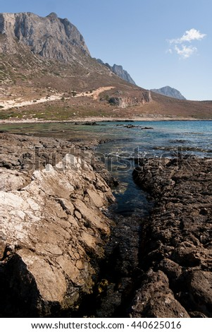 Rocky Mountains and a Lagoon in Crete - stock photo