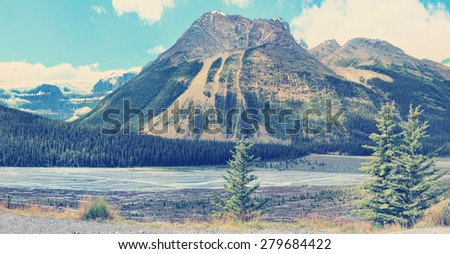Rocky mountains landscape in Banff National Park (Alberta, Canada).  Image done in vintage retro instagram style - stock photo