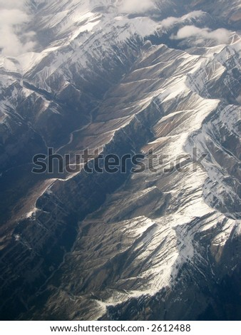 Rocky Mountains of Alberta, Canada; aerial view of thrust mountains with strong dip slope - stock photo