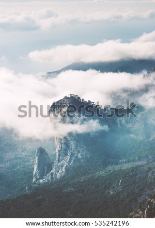 Rocky Mountains peak cliff and clouds foggy Landscape Travel aerial view serene misty scenery