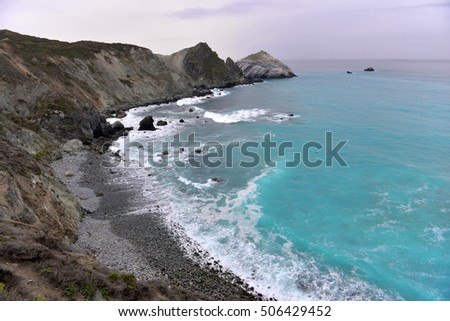 rocky ocean shore with turquoise water