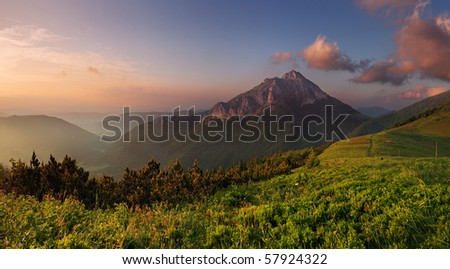 Rocky peak at sunset - stock photo