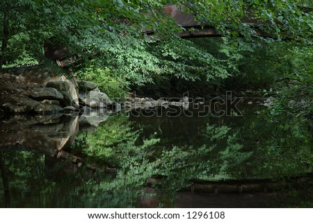 rocky reflection - stock photo