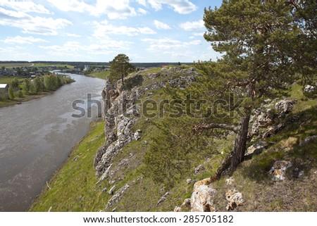 Rocky river Chusovaya in the village of Sloboda. Sverdlovsk region. Russia - stock photo