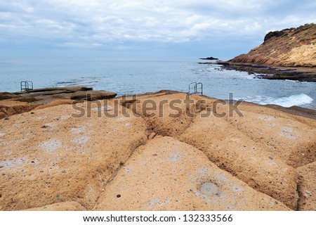 Rocky shore beach with big boulders - stock photo