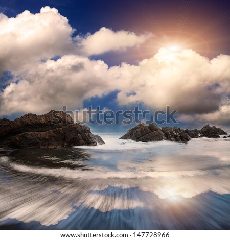 rocky shore on a windy day  - stock photo
