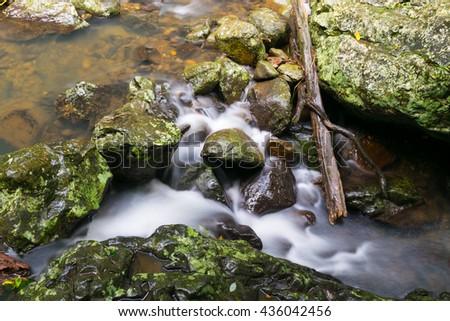 Rocky Stream in creek flowing water - stock photo