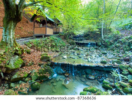 Rocky Stream, Running Through Autumn Mountain Forest and belvedere - stock photo