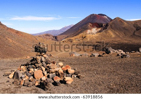 Rocky Tongariro crossing leading to Mt Doom, Ngauruhoe, New Zealand - stock photo
