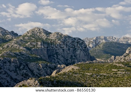 Rocky tops of the national park Paklenica and the clouds - stock photo