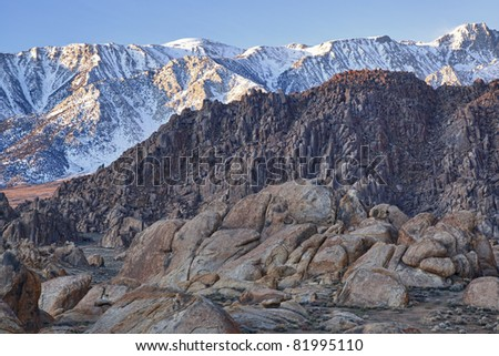 Rocky, winter landscape of the Alabama Hills with the Eastern Sierra Nevada Mountains in the background near Lone Pine, California, USA - stock photo
