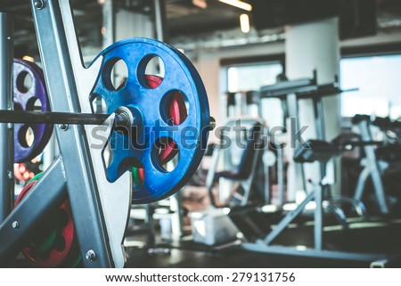 Rod with weights in the gym - stock photo