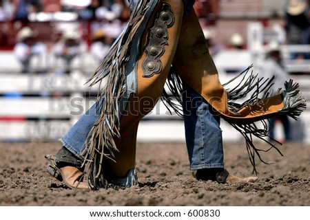 Rodeo cowboy and chaps at a rodeo (shallow focus). - stock photo