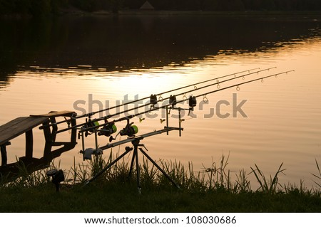 rods in the sunset on the lake, landscape image