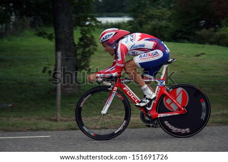 ROERMOND, HOLLAND - AUGUSTUS 12 : Proffesional cyclist From team Team Katusha during time trial of Eneco cycling tour August 12, 2011 in Roermond, Holland.  - stock photo