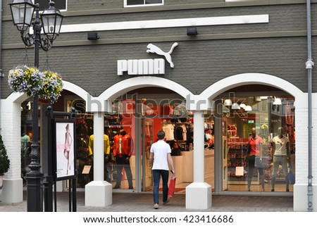 ROERMOND, NETHERLANDS - MAY 10, 2016: Puma brand store in The Designer Outlet Roermond owned by McArthur Glen. The McArthurGlen Group is a public company, and managed 25 plus designer outlet malls. - stock photo