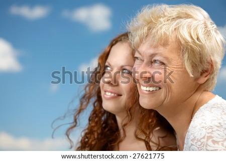rofile a family portrait against the blue sky - stock photo