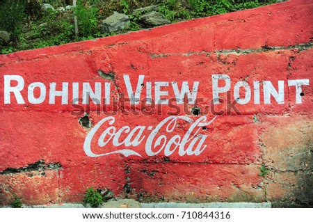 ROHINI, INDIA - APRIL 16: Painted of Rohini View Point and Coca-Cola logo on the wall on April 16, 2016, Rohini View Point is a small stop point during the way from Darjeeling to Sikkim, India