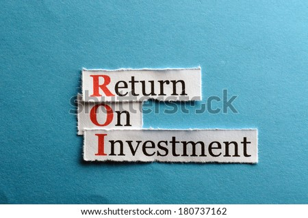 ROI acronym on blue paper, Return On Investment  - stock photo