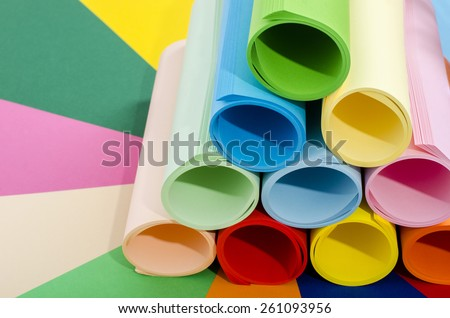 Roles of color paper. Color paper rolled and piled. Stack of paper on multicolor background. - stock photo