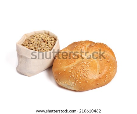roll bun whit sesame and wheat in sack - stock photo