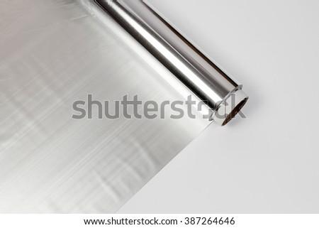 roll of aluminum gray foil paper - stock photo