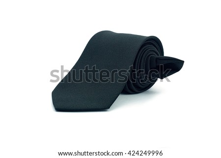 Roll of black necktie on white background - stock photo