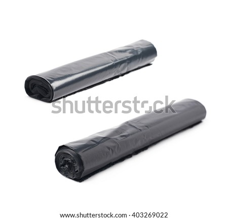 Roll of black plastic garbage bags isolated over the white background, set of two different foreshortenings - stock photo
