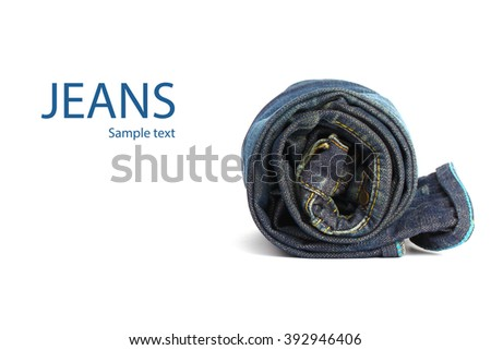 roll of blue jeans on a white background - stock photo