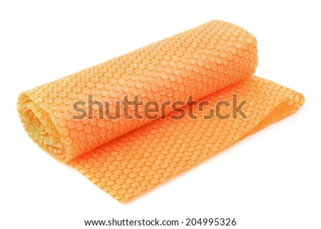 Roll of bubble wrap isolated on white - stock photo