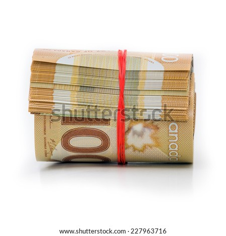 Roll of Canadian banknotes wraped with a rubber band - stock photo