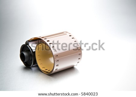 roll of film 35mm closeup on brushed metal background - stock photo