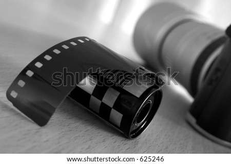 roll of film with slr camera - stock photo
