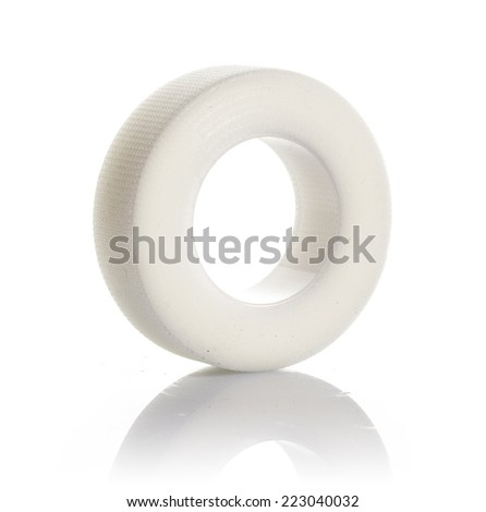 roll of medical sticking plaster on a white background isolated