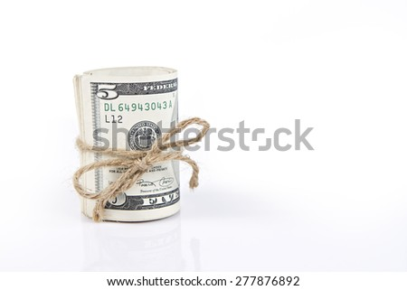Roll of money on isolated white