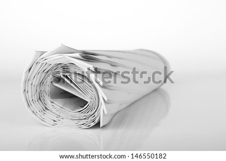Roll of newspaper isolated on white background