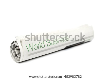 Roll of newspaper with World Business headline on white background. Image with selective focus.