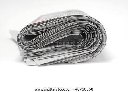 Roll of old newspapers - stock photo