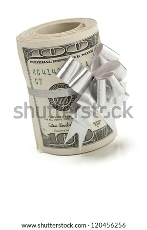 Roll of One Hundred Dollar Bills Tied in a Silver Bow on a White Background. - stock photo