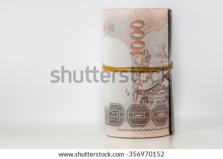 Roll of 1000 Thai Baht Notes - stock photo