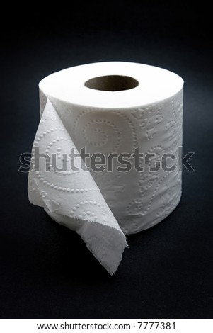 roll of toilet paper on black background - stock photo
