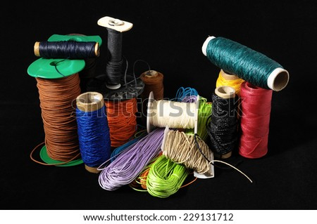Roll of Twine isolated on a Black Background - stock photo