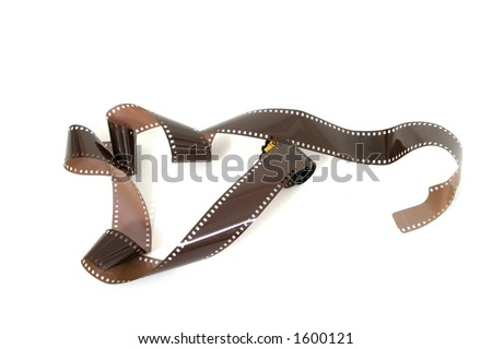 Roll of unexposed and unprocessed 35mm film and film cassette unwound.  Isolated on white background. - stock photo