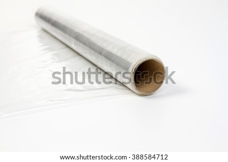 roll of wrapping plastic stretch film - stock photo