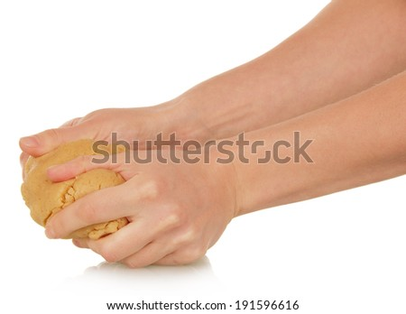 Roll out the dough in female hand isolated on white background
