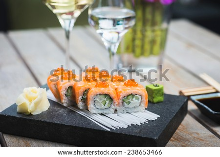 Roll set served on a plate on a table in a restaurant - stock photo
