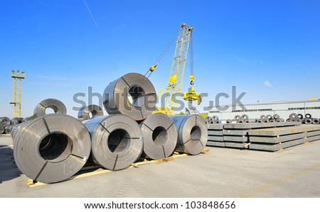 roll steel in harbor, Cold rolled steel coils - stock photo