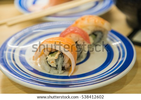 Roll sushi with salmon and rice in restaurant in Japan